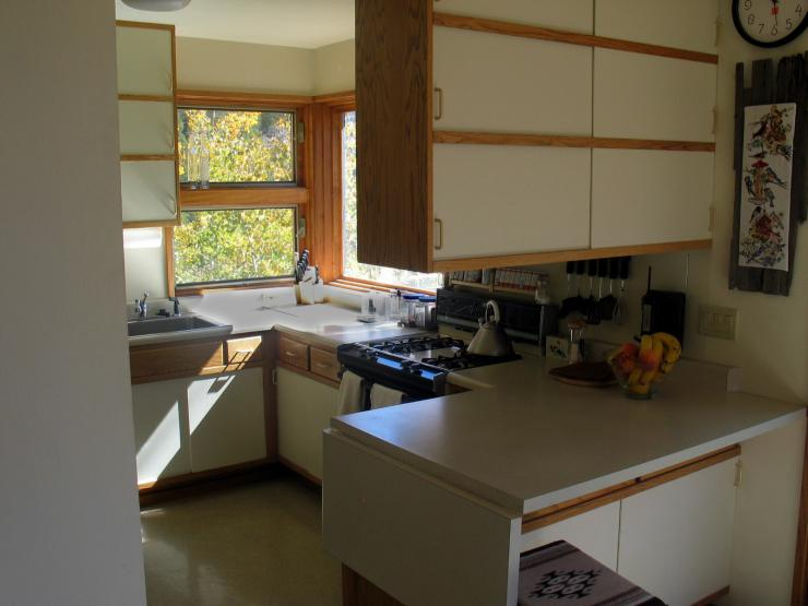The house has a large kitchen, with gas stove, dishwasher, fridge, all the comforts of home
