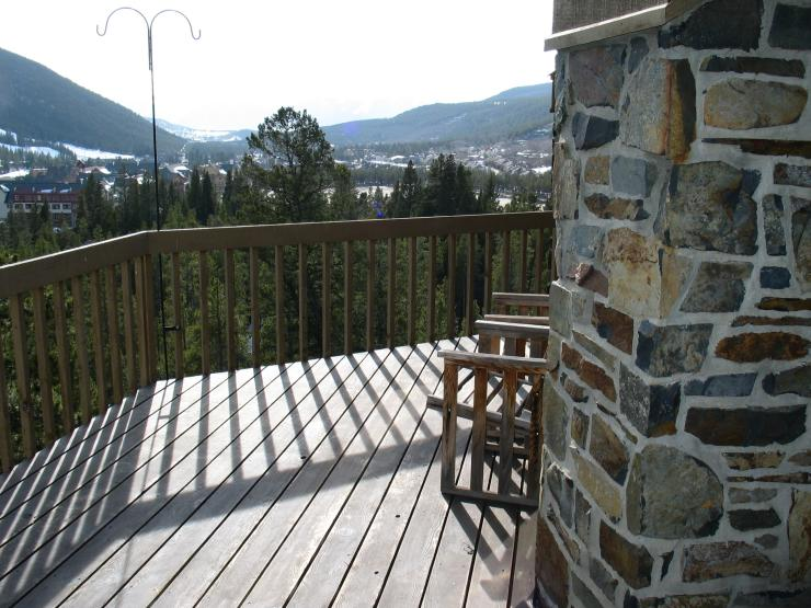 The large deck is a perfect place to unwind after a long day, watching the sun set over the beautiful Rocky Mountains
